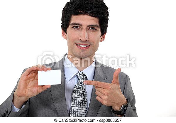 A businessman showing his card. - csp8888657