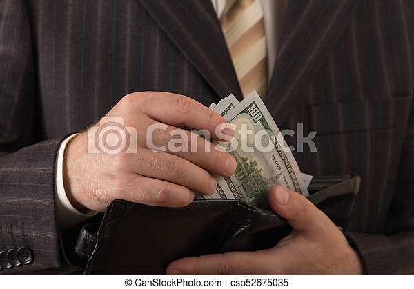 A businessman takes out money from his wallet. Close-up - csp52675035