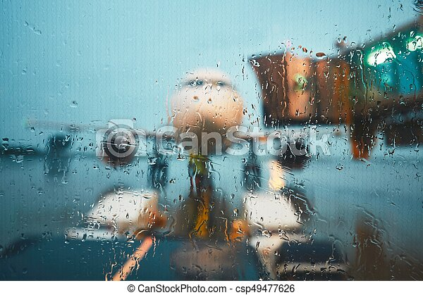 A busy airport in the rain - csp49477626
