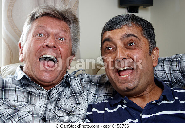 A caucasian and asian man sitting together - csp10150756