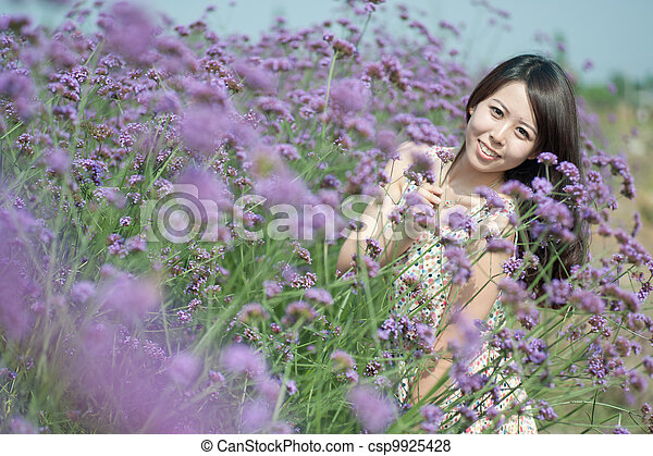 A Chinese young women playing in the vast lavender - csp9925428