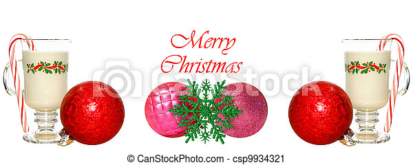 A Christmas setting with a couple glasses of cold Eggnog with Candy Canes, some poinsettia plants and some Christmas decorative balls (baubles) and a snowflake whising you a Merry Christmas. - csp9934321