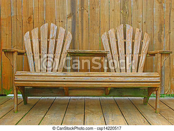 Terrific A Close Up Of A Dual Wooden Seat With A Center Table On A Wooden Deck Patio With A Fence Behind It For Privacy Short Links Chair Design For Home Short Linksinfo