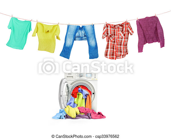 A close up of a washing machine loaded with clothes and clothes on the ropes isolated on white background - csp33976562