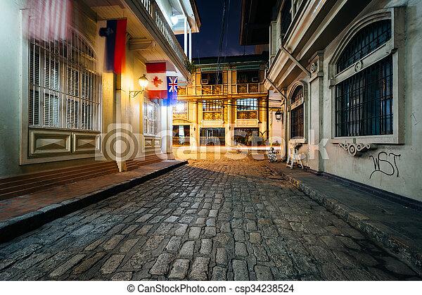 A cobblestone street at night, in Intramuros, Manila, The Philippines. - csp34238524