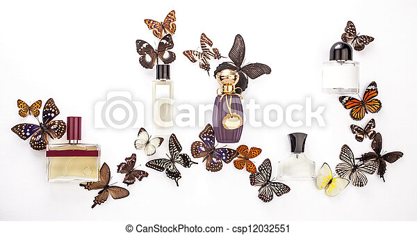 A composition of perfume bottles with butterflies on white background - csp12032551