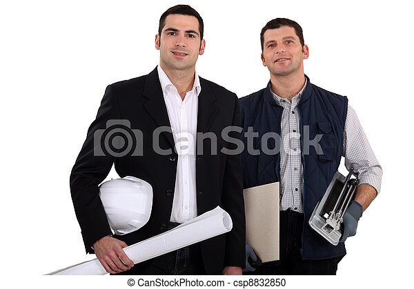 a construction manager and a  worker with a tile cutter - csp8832850