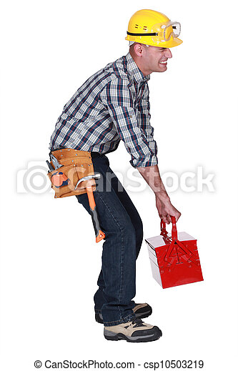 A construction worker with a heavy toolbox. - csp10503219
