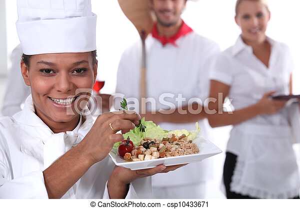 a cook holding a dish, a pizza cook and a waitress dressed in uniform - csp10433671