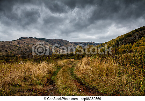 A country road in the mountains - csp86360569