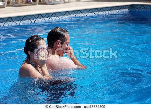 A couple having fun in a  pool - csp13332809