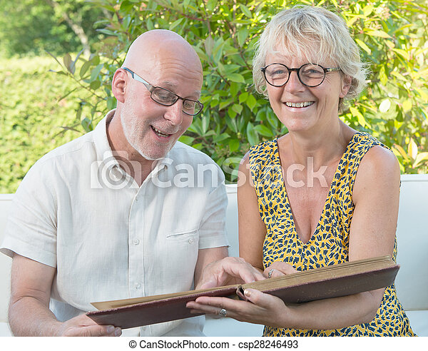 a couple looking at a photo album - csp28246493