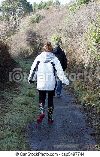 A couple on a country walk - csp5497744
