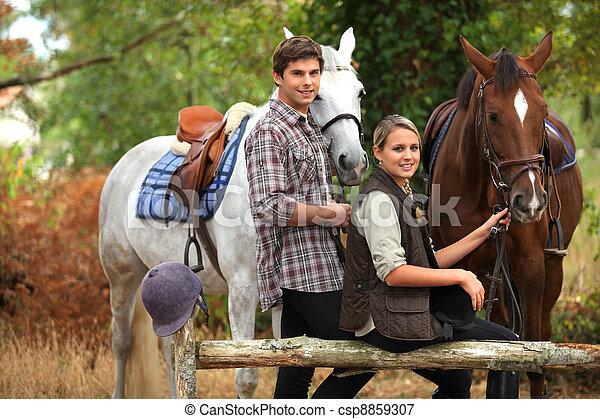 A couple on a horse ride. - csp8859307