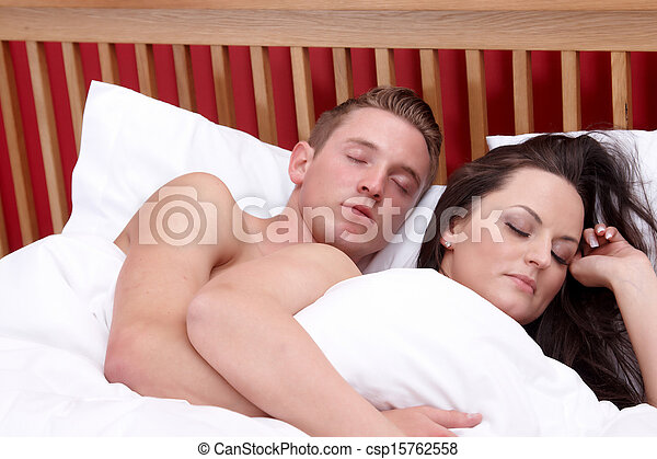 A couple sleeping in bed - csp15762558