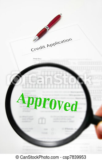 a credit application and magnifying glass with Approved text - csp7839953