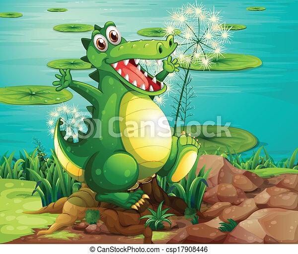 A crocodile above the stump near the pond - csp17908446
