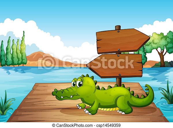 A crocodile near the pond - csp14549359