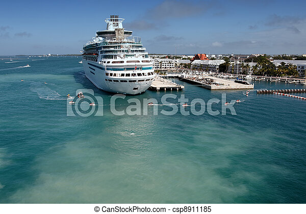 A cruise ship docked and anonymous people - csp8911185