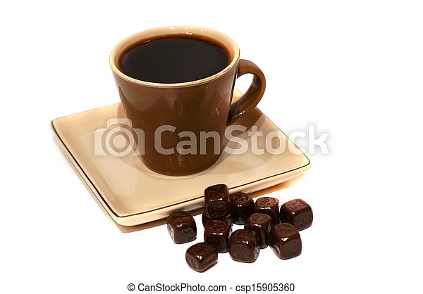 A cup of black coffee with chocolate candies - csp15905360