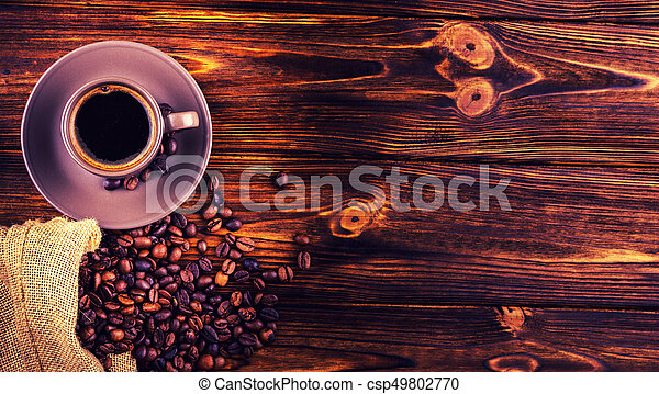 A cup of coffee on a wooden background with space for your text - csp49802770