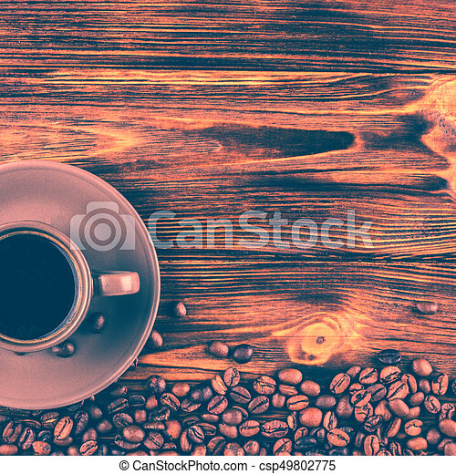 A cup of coffee on a wooden background with space for your text - csp49802775