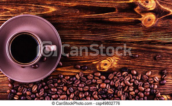 A cup of coffee on a wooden background with space for your text - csp49802776