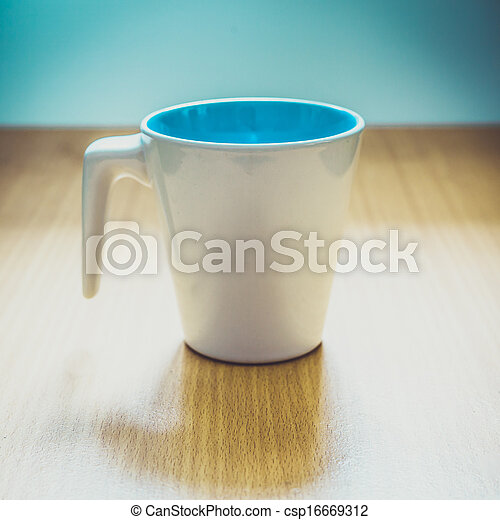 A cup of coffee on wooden background - csp16669312