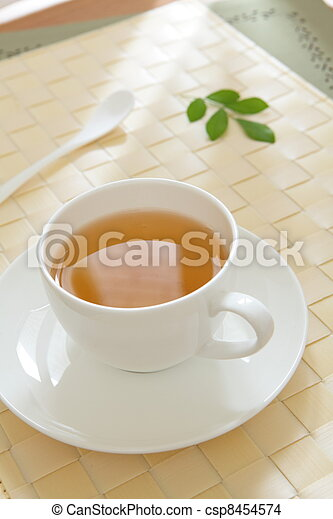 a cup of green tea with morning sunlight - csp8454574