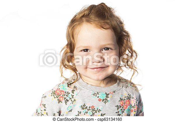 A cute Little Girl with redhead in studio white background - csp63134160