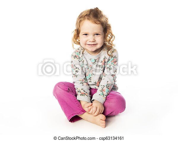 A cute Little Girl with redhead in studio white background - csp63134161