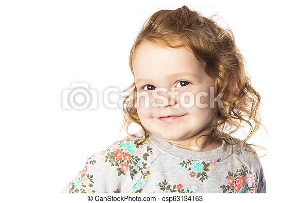 A cute Little Girl with redhead in studio white background - csp63134163