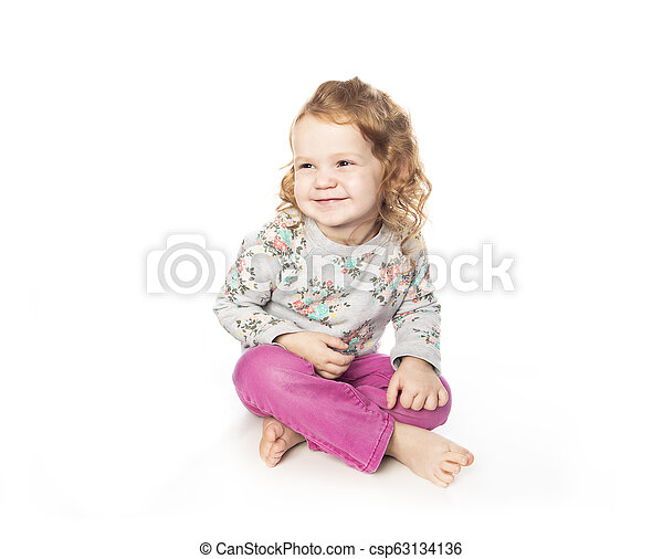 A cute Little Girl with redhead in studio white background - csp63134136