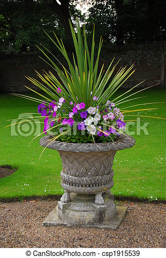 A Decorative Stone Garden Urn With Plants An Old Decorative Garden