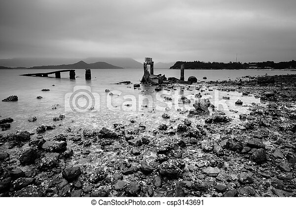 a desolate and broken peer on the beach - csp3143691