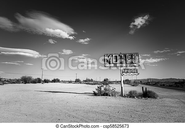 A dilapidated, vintage motel sign in the desert of Arizona - csp58525673