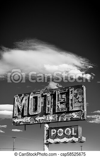 A dilapidated, vintage motel sign in the desert of Arizona - csp58525675