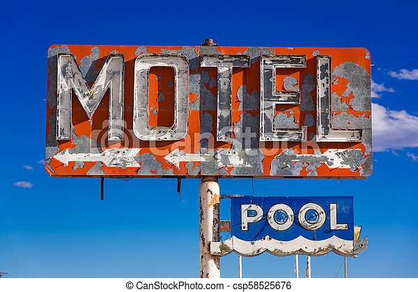 A dilapidated, vintage motel sign in the desert of Arizona - csp58525676