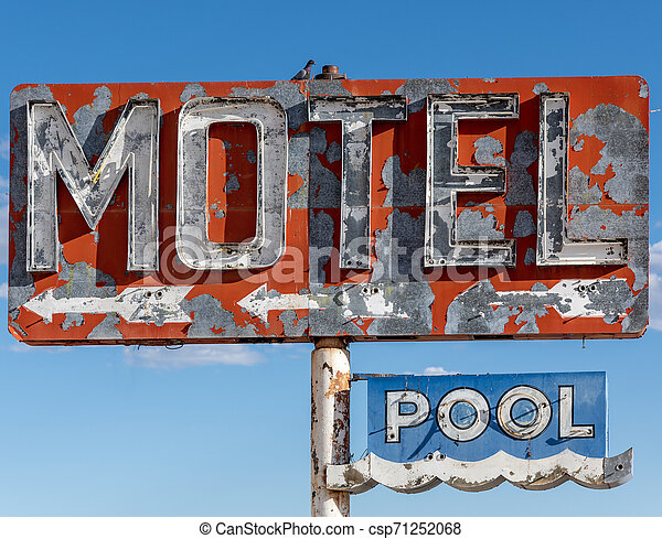 A dilapidated, vintage motel sign in the desert of Arizona - csp71252068