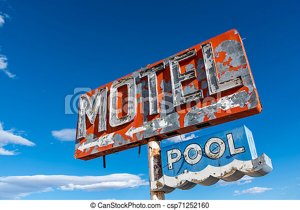 A dilapidated, vintage motel sign in the desert of Arizona - csp71252160