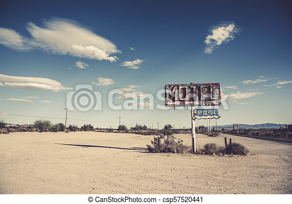 A dilapidated, vintage motel sign in the desert of Arizona - csp57520441