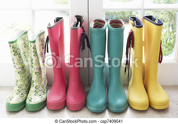 A display of colorful rain boots - csp7409541