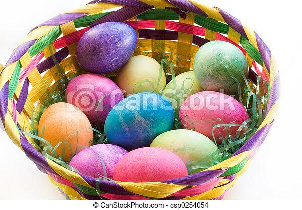 A Dozen Easter Eggs in an Easter Basket - csp0254054