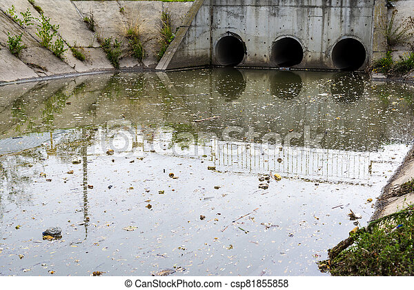 A drain pipe or sewage or sewage discharges waste water into a river. Wastewater or domestic wastewater or municipal wastewater that is a product of a community of people - csp81855858