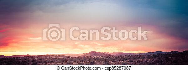 A dramatic cloudy panorama sunset in the desert of Arizona - csp85287087