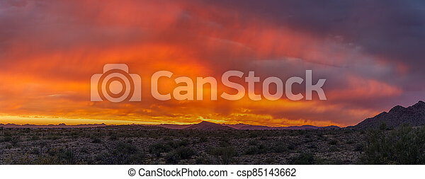 A dramatic cloudy panorama sunset in the desert of Arizona - csp85143662