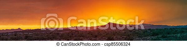 A dramatic cloudy panorama sunset in the desert of Arizona - csp85506324