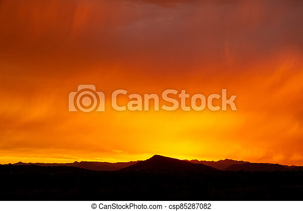 A dramatic cloudy sunset in the desert of Arizona - csp85287082