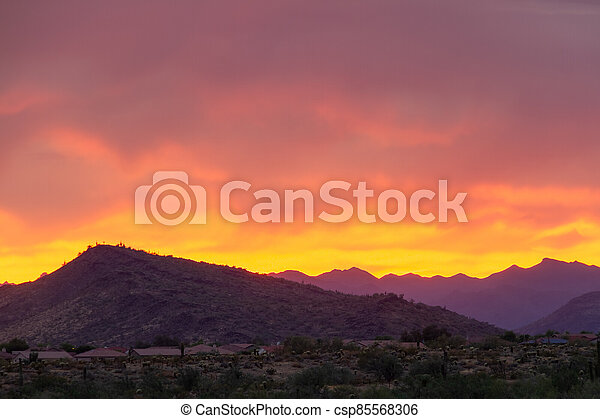 A dramatic cloudy sunset in the desert of Arizona - csp85568306