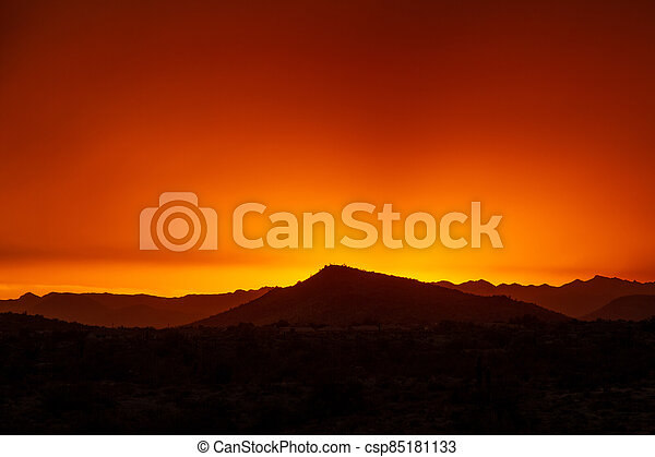 A dramatic cloudy sunset in the desert of Arizona - csp85181133